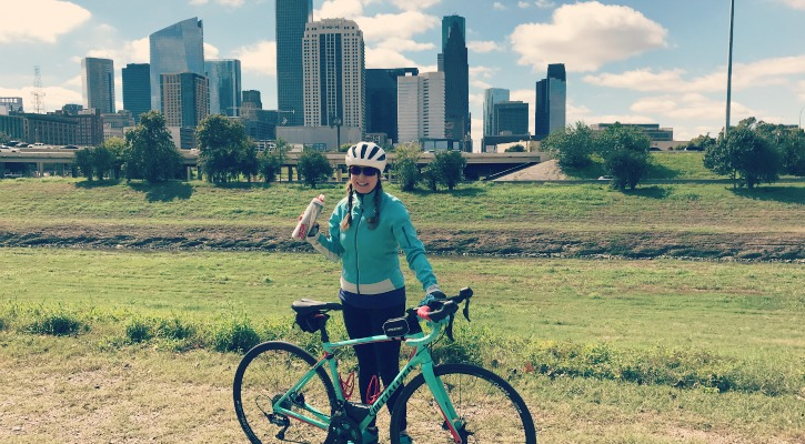 Sara bike picture in front of Houston city