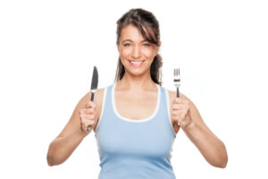 Picture of woman with knife and fork.